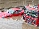 Drivers stuck in cars and rescued by firefighters as London's North Circular flooded by water main