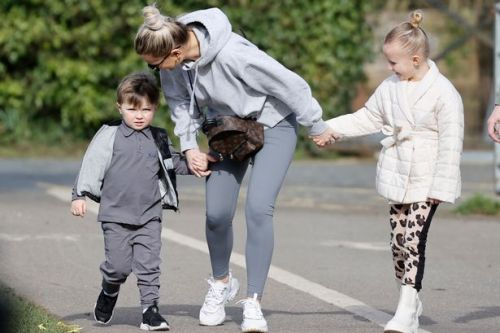 Billie Faiers kisses daughter Nelly, six, on family stroll with Greg and Arthur