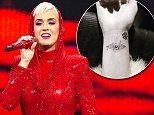 Katy Perry gets a new tattoo in Sydney to commemorate the end of her Witness tour