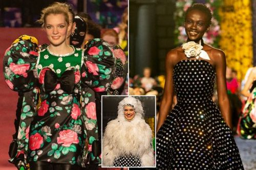 Moment fashion models break tradition and strut down catwalk smiling from ear to ear