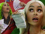 Blac Chyna counts stacks of money and dips into a pool in her new Cash Only music video