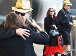 Molly Shannon and Will Ferrell hug at JFK before jetting to the UK for their HBO Royal Wedding gig
