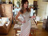 Lizzie Cundy performs the YMCA in her dining room wearing a sparkling silver off-the-shoulder gown