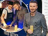 David Beckham takes a break from his healthy diet to get stuck into whisky cocktails