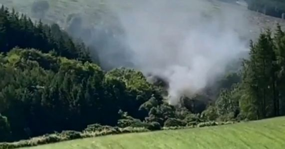 Train derails sending smoke into the air after night of heavy flooding