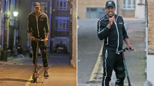 Anthony Joshua all smiles as he sports leg brace for lockdown scoot around London