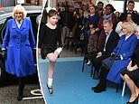Duchess of Cornwall braces the bad weather in a royal blue coat