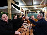 At last, it's the Glorious 12th! Thirsty drinkers rush to pubs in the snow at midnight