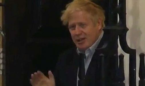 Boris Johnson seen outside for first time since coronavirus diagnosis as PM claps for NHS