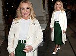 Amanda Holden looks chic in a forest green skirt and elegant cream coat