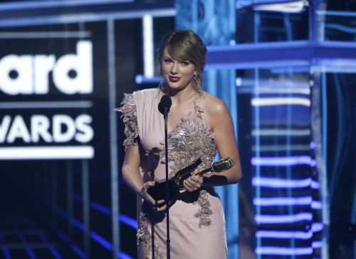 Taylor Swift thanks 'the female artists who paved the way' as she accepts two Billboard Music Awards