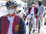 Robert Downey Jr. covers up in a colorful coat while riding his bike with a friend in Malibu