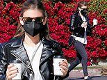 Kate Mara sports chic motorcycle jacket and skinny jeans while juggling cups of coffee in Los Feliz