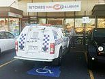 Drivers slam 'donut-scouting' police officers for parking in a disabled spot outside an IGA