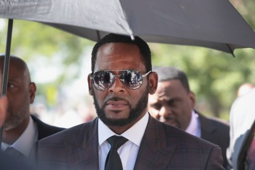 R Kelly's friends 'charged with threatening witnesses' amid sex assault case