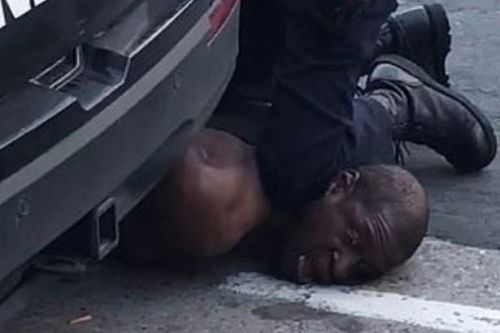 Handcuffed black man dies after white policeman kneeled on his neck