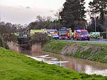 Man 52 and woman 21 die after car falls off bridge into water Chapel St Leonards Lincolnshire