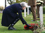 Theresa May pays her respects to fallen soldiers in Belgium and France