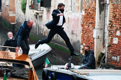 Tom Cruise leaps across boats like it's nothing as filming on Mission: Impossible 7 continues in Venice