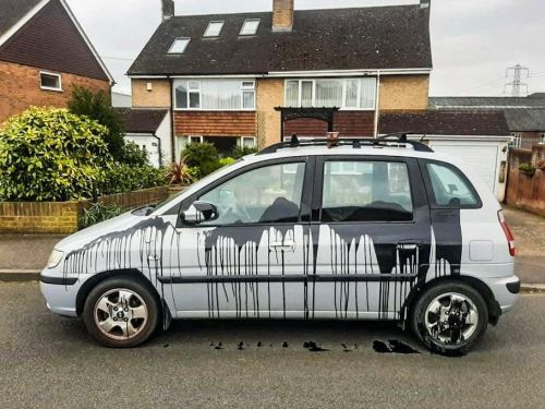 Emergency worker's car covered in black paint while he was working