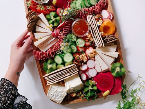 Influencers posting artsy photos of 'adult Lunchables' are blowing up among millennials with small living spaces and a passion for meat and cheese