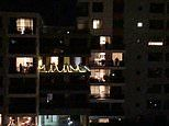 Sydney apartment complex performs 'I Still Call Australia Home' from their balconies