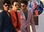 The Jonas Brothers rock colorful 80's-inspired suits during shoot for their upcoming new music video