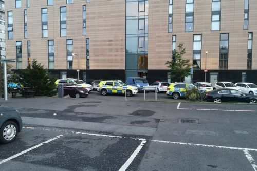 Armed police race to Glasgow flats after 'ongoing incident' in West End