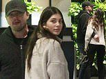 Leonardo DiCaprio hugs girlfriend Camila Morrone her while waiting for their car in Beverly Hills