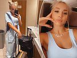 Tammy Hembrow shows off her washboard abs in a crop top as she jets to Milan Fashion Week