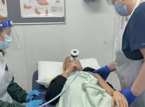 Dancing On Ice's Denise Van Outen inhales gas and air as doctor puts dislocated shoulder back in place