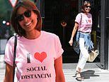 Melanie Sykes, 49, looks casually chic in an 'I love social distancing' slogan T-shirt