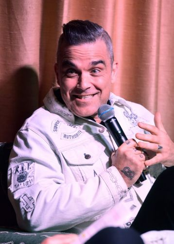 Robbie Williams Reveals The Staggering Number Of Toilets He Has In His Home And We Have So Many Questions