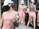 Hailey Bieber flashes her abs in a bra top and shorts as she leaves a hot yoga session in SLIPPERS