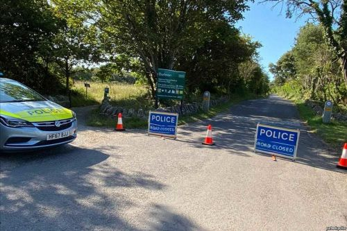 Two bodies found in a car at a Dorset beauty spot