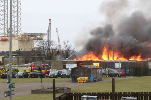 Staff banned from using old laptops as more than 50 firefighters battle school blaze