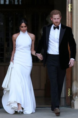 Prince Harry leaves guests at wedding reception in tears as he refers to Meghan Markle as his 'wife' for FIRST time