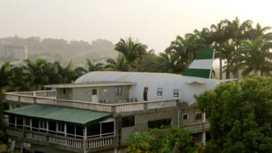 A man in Nigeria built his wife a house that looks like a giant plane because she 'loves to travel'