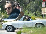 Harry Styles drives his classic Mercedes Benz in LA