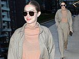 Gigi Hadid looks effortlessly chic in a muted ensemble as she steps out amid Milan Fashion Week