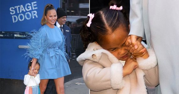 Chrissy Teigen's daughter Luna is in no mood for paparazzi during day out and we feel for her