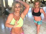 Britney Spears dances barefoot in two midriff-baring ensembles and whips her hair in Instagram video