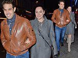 Kelly Brook cosies up to boyfriend Jeremy Parisi on evening stroll in London