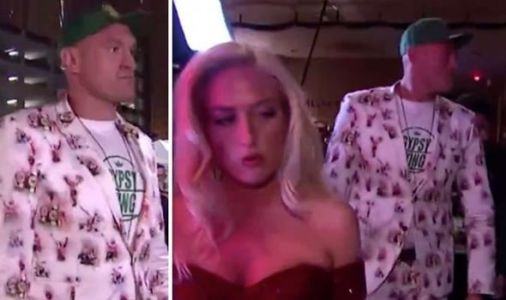 Tyson Fury arrives for Deontay Wilder rematch laughing in crazy suit alongside wife Paris