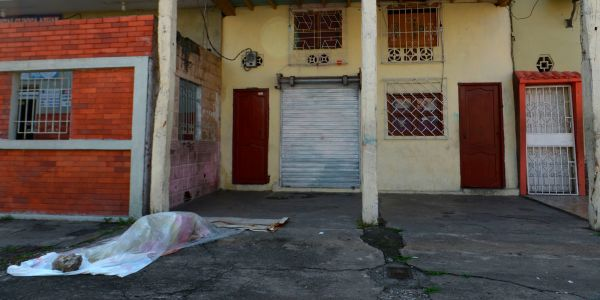 Morgues are so overfilled in Ecuador's largest city from the coronavirus outbreak that bodies are being left in homes or the streets