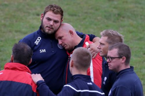 Heartbroken rugby players lay club jacket of shot policeman in moving tribute