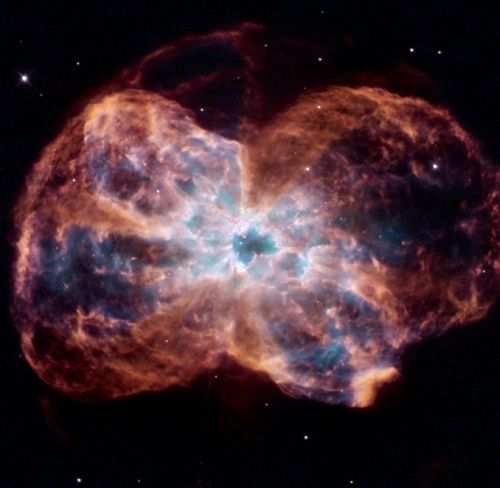 Previewing the Sun's fate: a white dwarf blazing in the colourful shroud of a planetary nebula