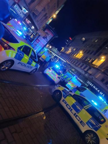 Four injured in stabbing as witnesses report seeing 'man slashed and pouring with blood' in street in Manchester