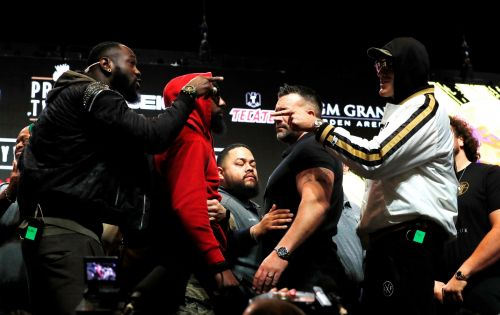 Tyson Fury and Deontay Wilder in heated stand-off at final press conference