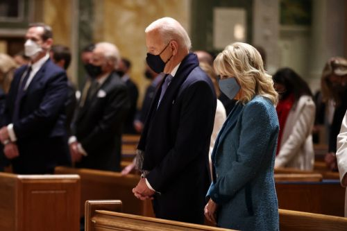 Biden attends church in Washington as Trump bids farewell to White House